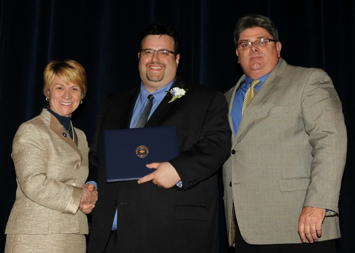 Twenty-Year Club Inductee, Mark Ledoux with President Warren and Vice President Jarvie