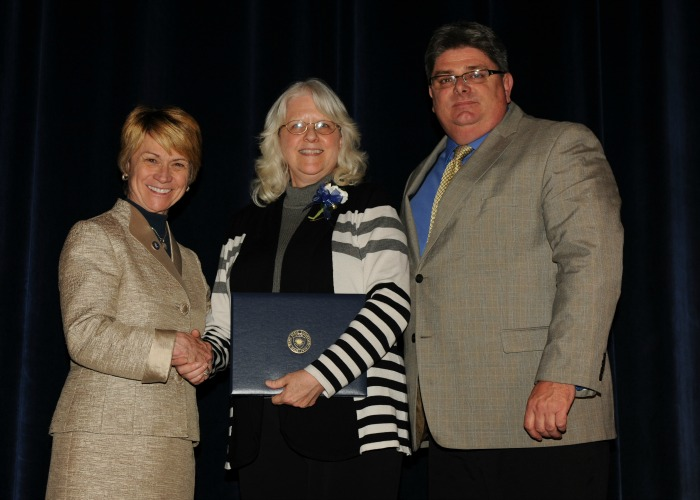 Inductee Vickie McFarlan with President Warren and Vice President Jarvie