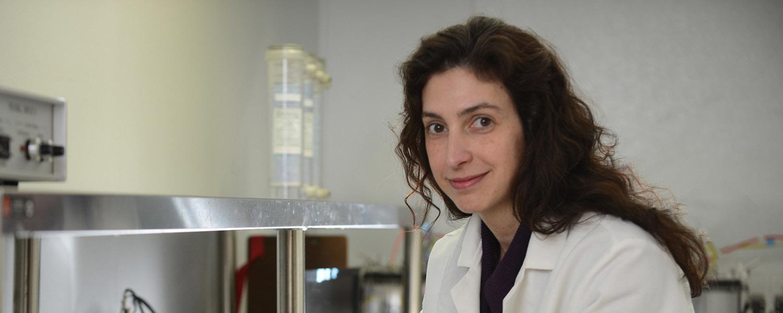 Associate Professor of Biological Sciences Colleen Novak works in her lab.