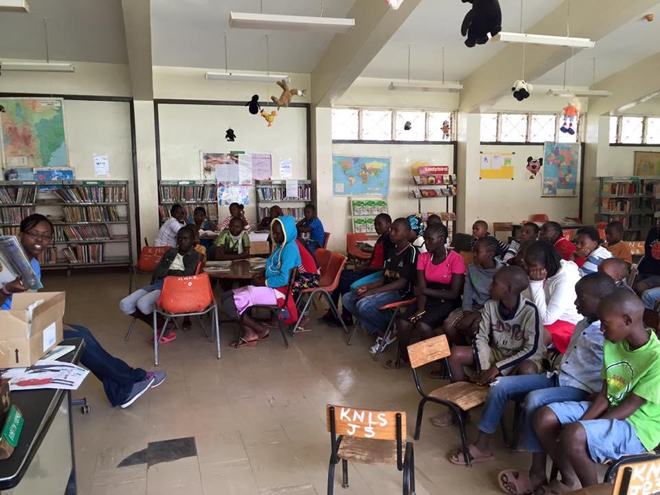 SLIS Student Kymberlee Powe Reading to Children in Kenya