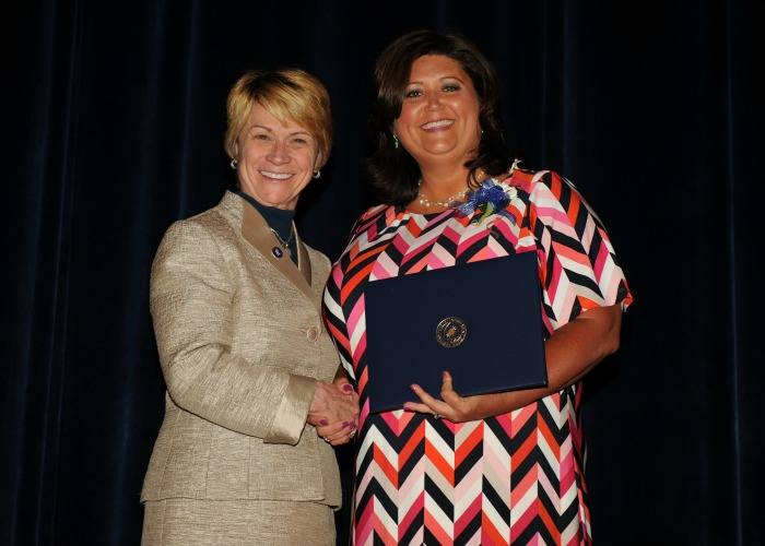 Inductee Julie Spotts shakes hands with President Warren
