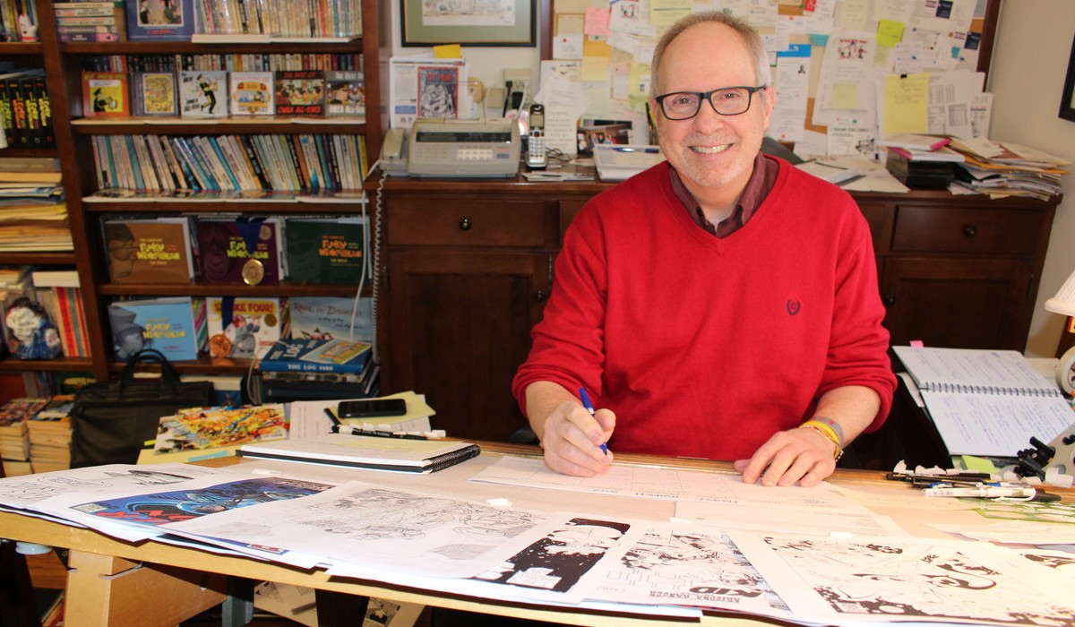 Tom Batiuk at the  drawing board in his  studio in Medina, Ohio. Photo credit: Erin Baka