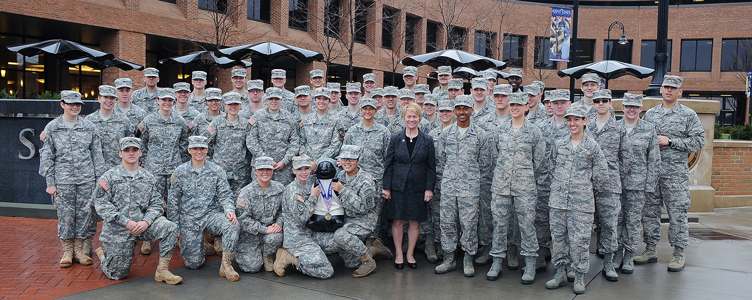 Kent State President Beverly Warren stands with both Kent State ROTC detachments on the Risman Plaza.