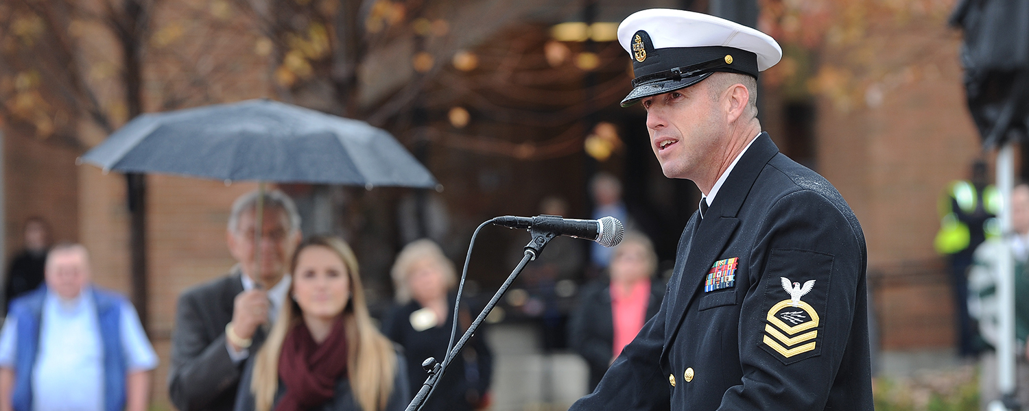 Chief Petty Officer Timothy S. Flannery, guest speaker for the 2014 Kent State Veteran's Day ceremony, addresses those gathered on the Risman Plaza.