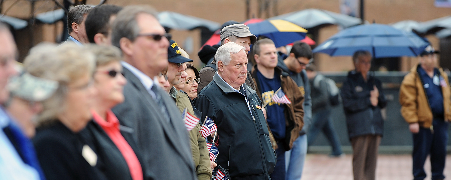 A veteran listens intently during Kent State's annual Veterans Day ceremony on Risman Plaza.