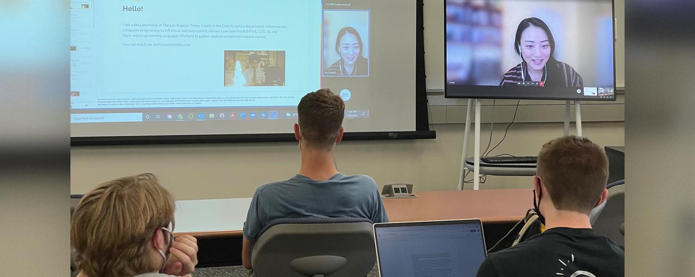 Iris Lee talking to students