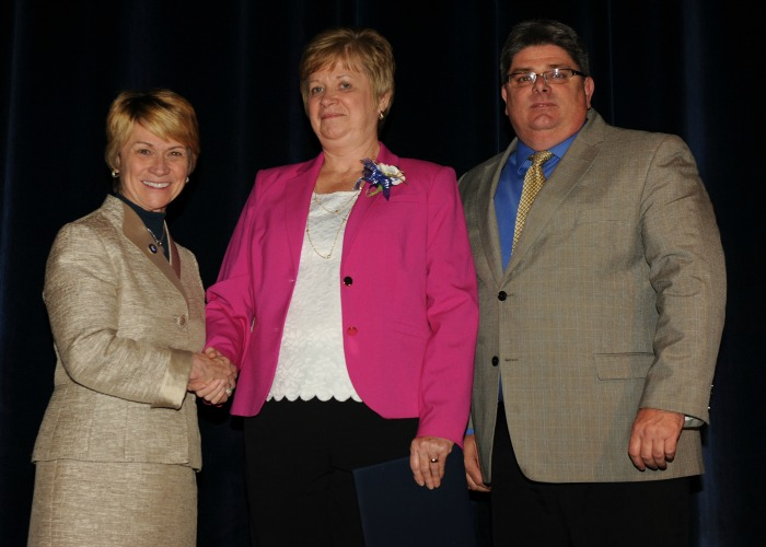 Alyce Wagner is congratulated by President Warren and Vice President Jarvie