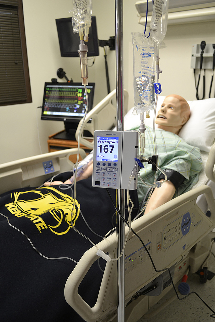 A smart-pump IV is shown giving a dose of high-risk IV medication to a 3G manikin