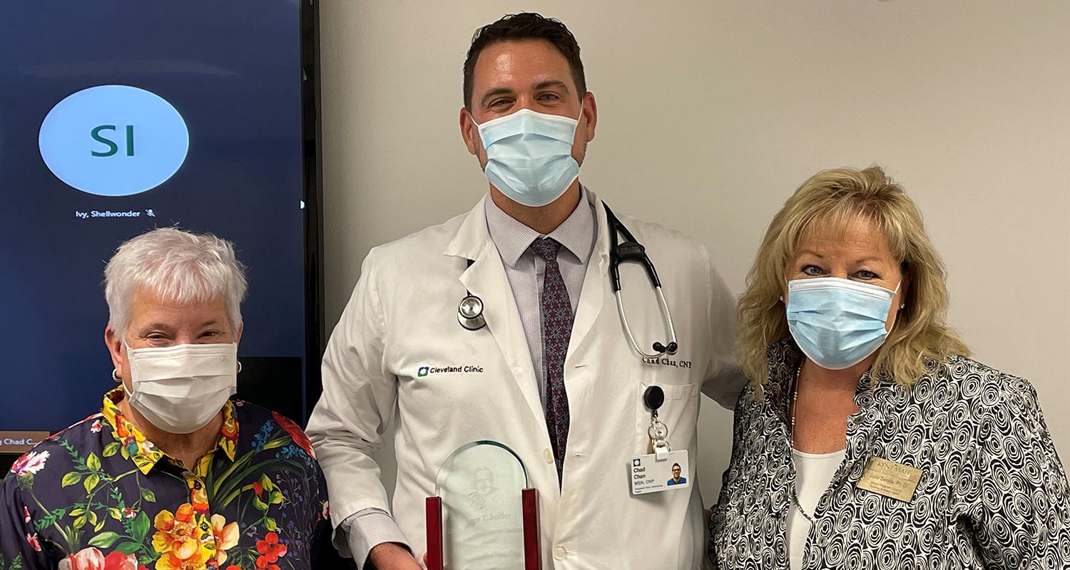 Chad Hollis-Chan, RN, MSN, CNP (center),  Kent State Ashtabula Dean and Chief Administrative Officer Susan J. Stocker, Ph.D., (left) and Senior Program Director for Nursing and Allied Health Julie Senita, Ph.D. (right).