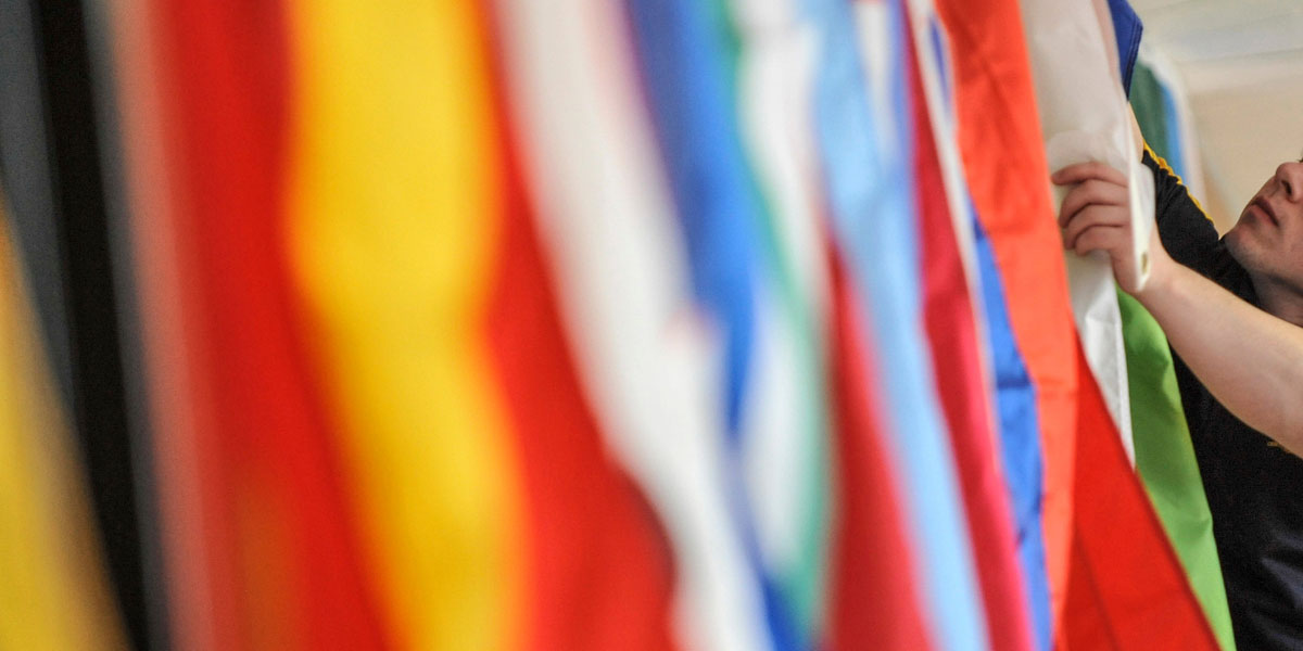 International flags hang in the Kent State Student Center.