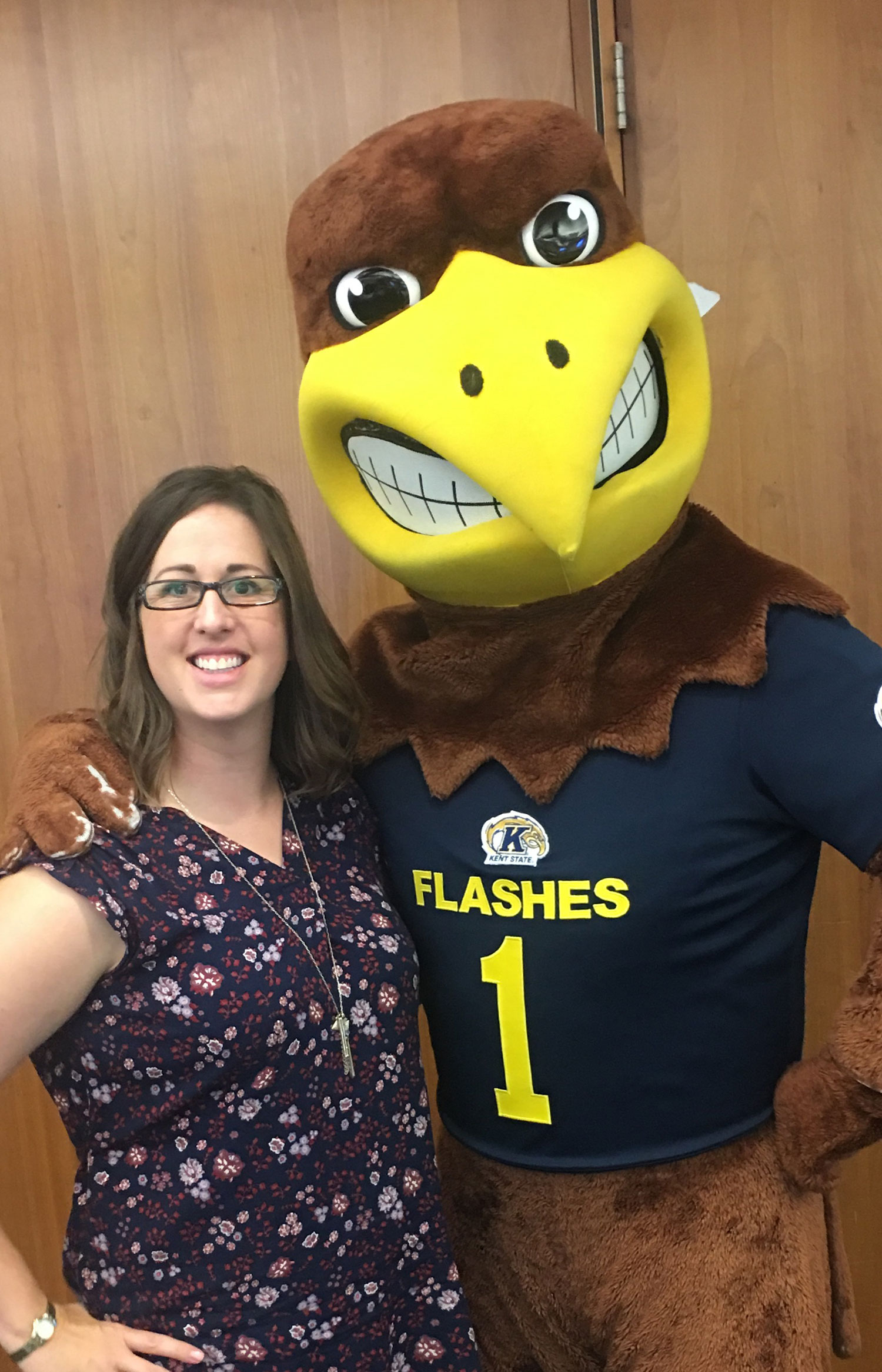 Lyndy Beckley and Kent State University mascot, Flash, pose for a photo.
