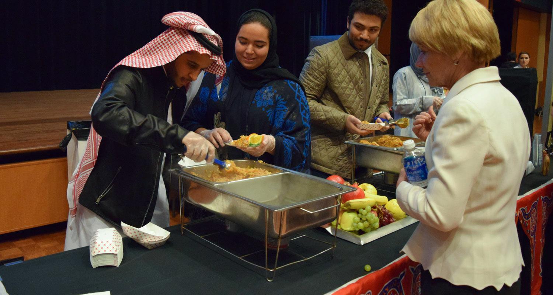 Team Saudi Arabia serves its winning dish to Kent State University President Beverly Warren during the 2016 International Cook-off event.