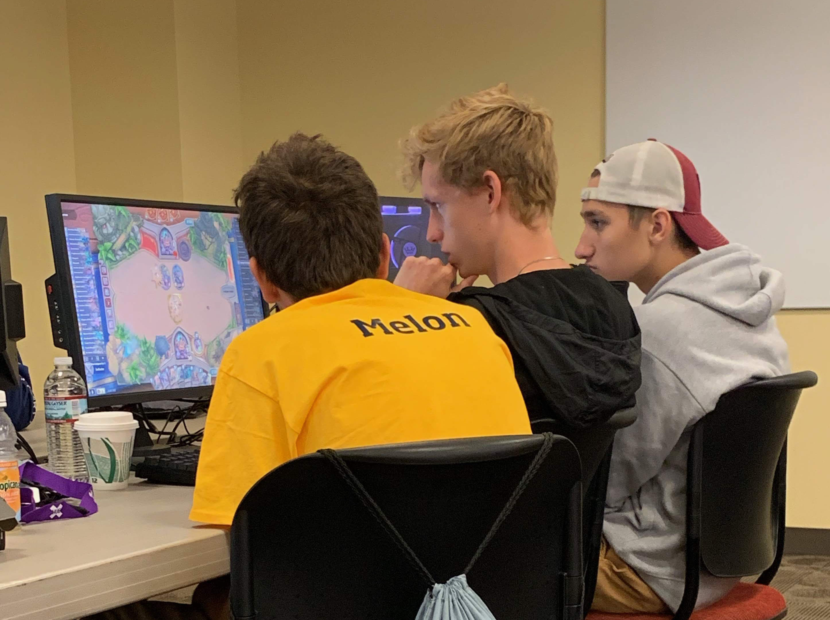 Early in the competition, the Kent State Hearthstone team members contemplate their next move against universities from around the country.