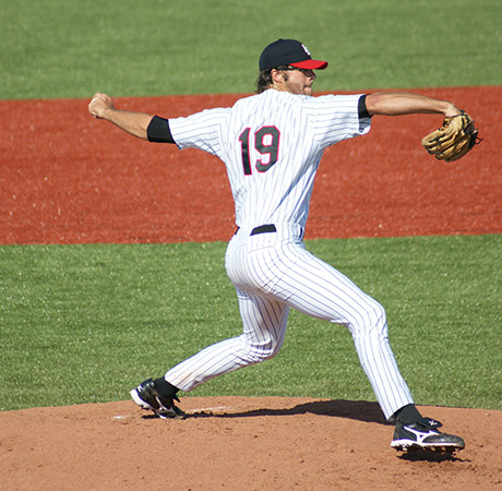 Cleveland Indian's baseball player throwing a pitch