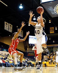 Shields playing on the Women's Basketball team