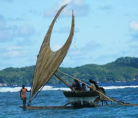 Sailing a traditional voyaging canoe on Taumako's reef in 2007.