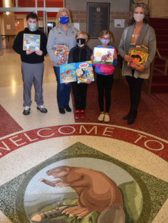 With the books at Beaver Local were (from left) Cayden Vincent, Debbie Riggs of Kent State, Brody Nign, Payton Smith and Mrs. Brianne Hall.