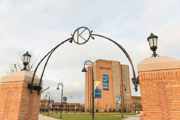 Kent State University Library shown through a campus archway