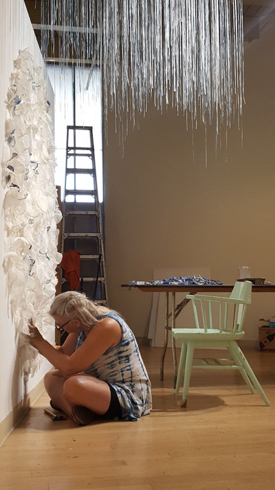Alumna Rebecca Cross working on her installation at the CAN Triennial