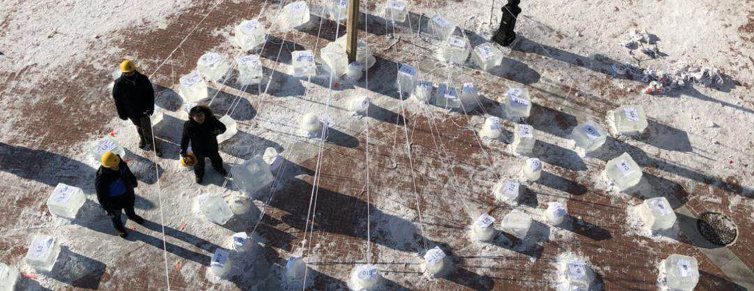 Kent State students arrange the frozen building blocks of their ice sculpture in Harbin, China.