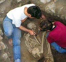 Archaeological excavation of an ancient human burial.