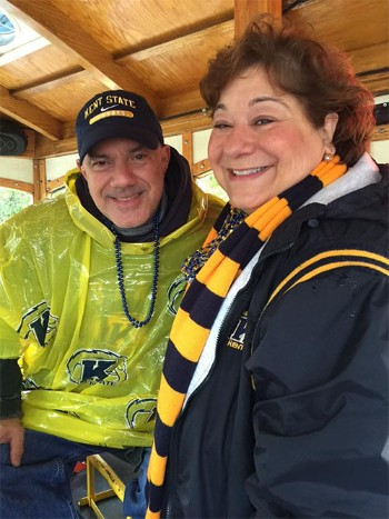 Bartz showing her Kent State spirit on Lolly the Trolley during the parade at Homecoming 2015.