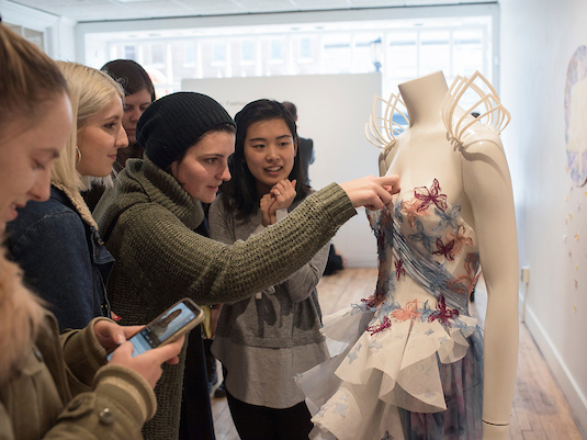 Fashion students working on a design