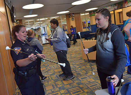 Students get to know members of the Kent State Police Department during the Coffee With a Cop event.