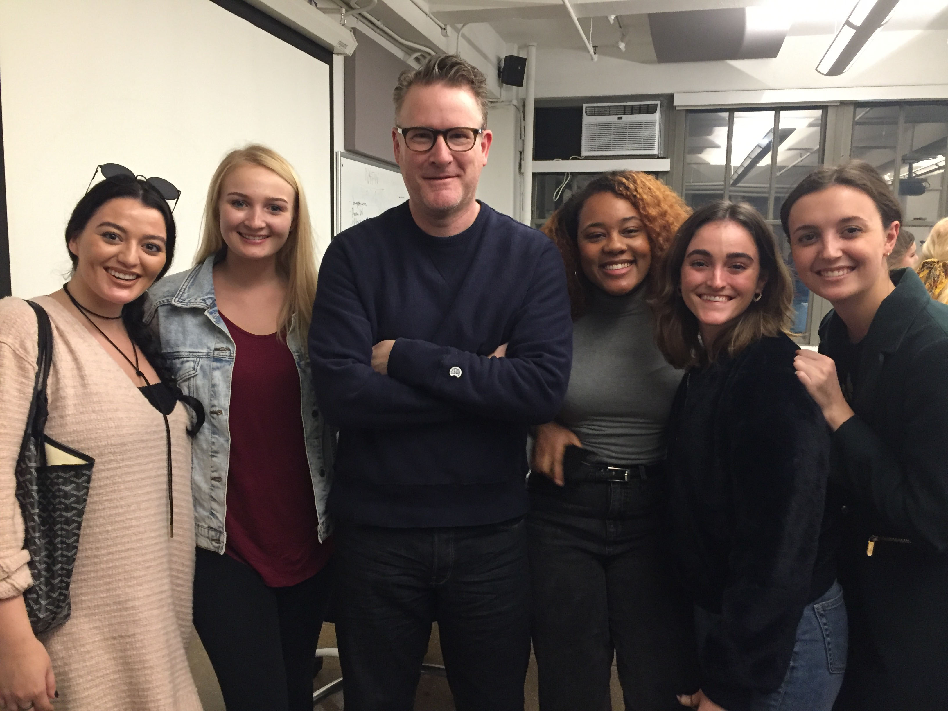 Students posing with guest lecturer