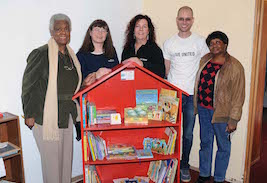 The first bookshelf built by Kent State University for the United Way of Portage County's Big Red Bookshelf project is delivered to a daycare center in Ravenna, Ohio. Pictured are (from left to right) Beatrice Mitchell, Sunday school superintendent at the Allen Chapel A.M.E. Church; Barb Boltz, project director for enrollment data and systems support at Kent State; Stephanie Rummel, director of development at the United Way of Portage County; Brian Duchon, president and CEO of the United Way of Portage County; and Shirley Powell, a member of the church.