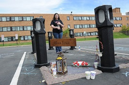A student stands vigil by the concrete lanterns in memory of Kent State University student Allison Krause, one of the victims of the May 4, 1970, shootings. The 44th annual commemoration of May 4, 1970, will take place May 3 and 4.