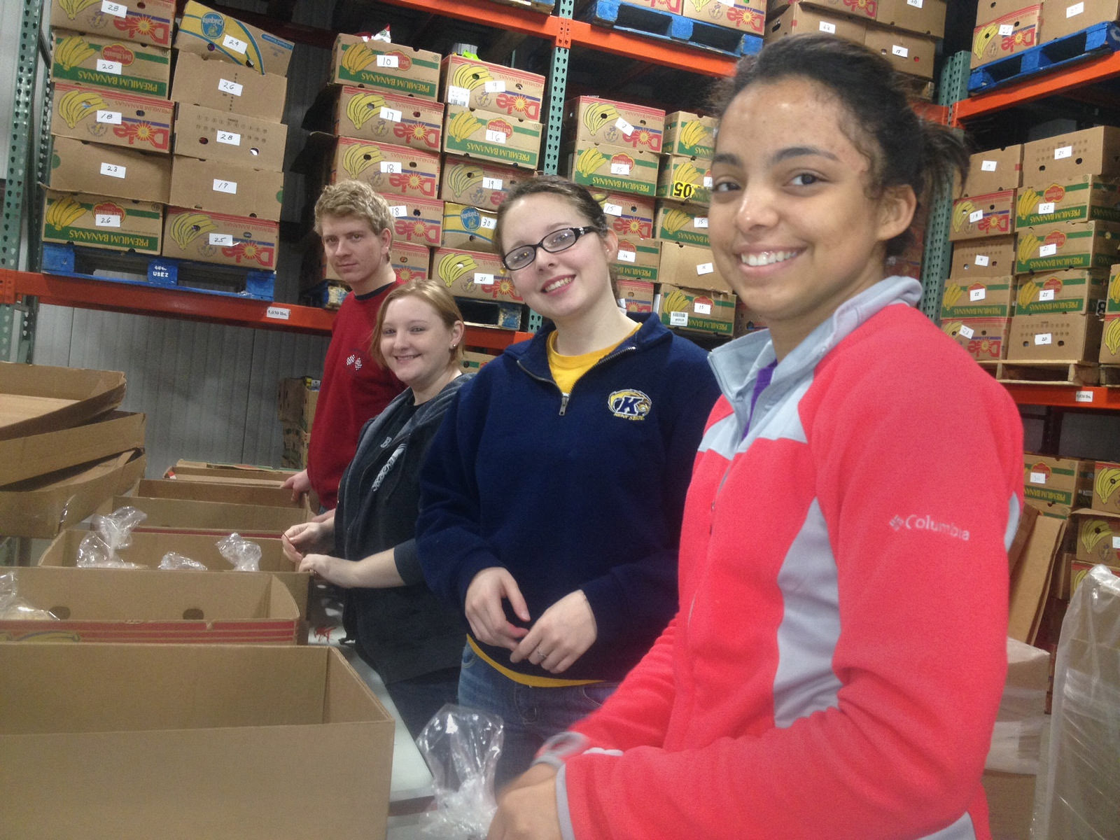 Photo of Kent State students volunteering at foodbank