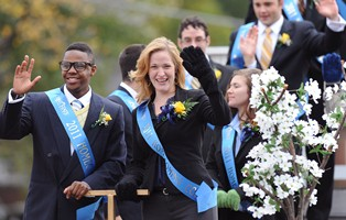 Members of the Kent State University 2011 Homecoming Court ride a float down Main Street during Kent State's 2011 Homecoming Parade
