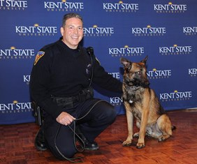 Officer Miguel H. Witt, of the Kent State University Police Department, poses with his new partner, Dexter, during a press conference introducing the male Belgian Malinois, trained as an explosive-detection canine.