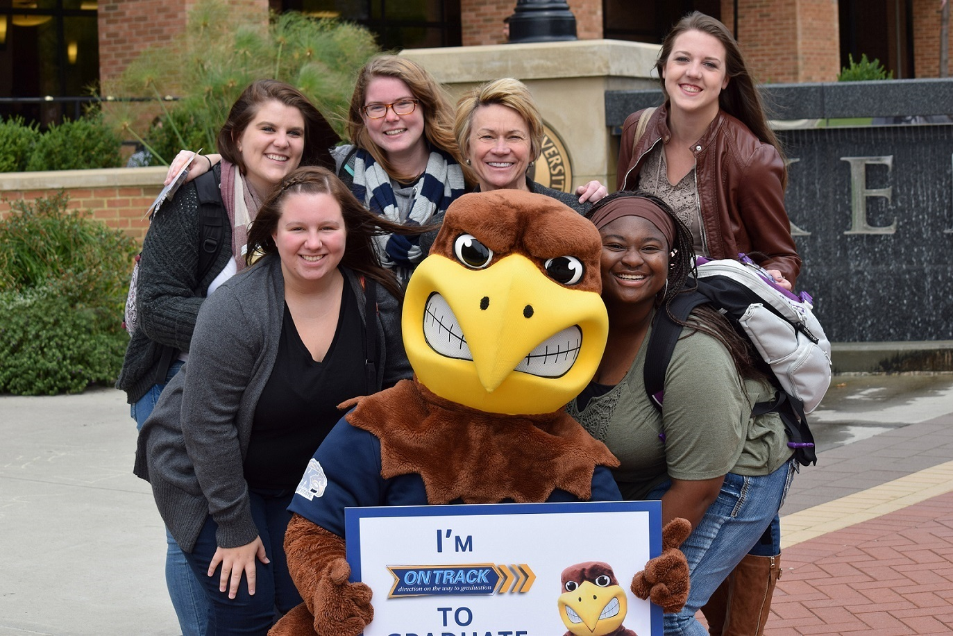 Photo of Kent State President Beverly Warren, Flash and students