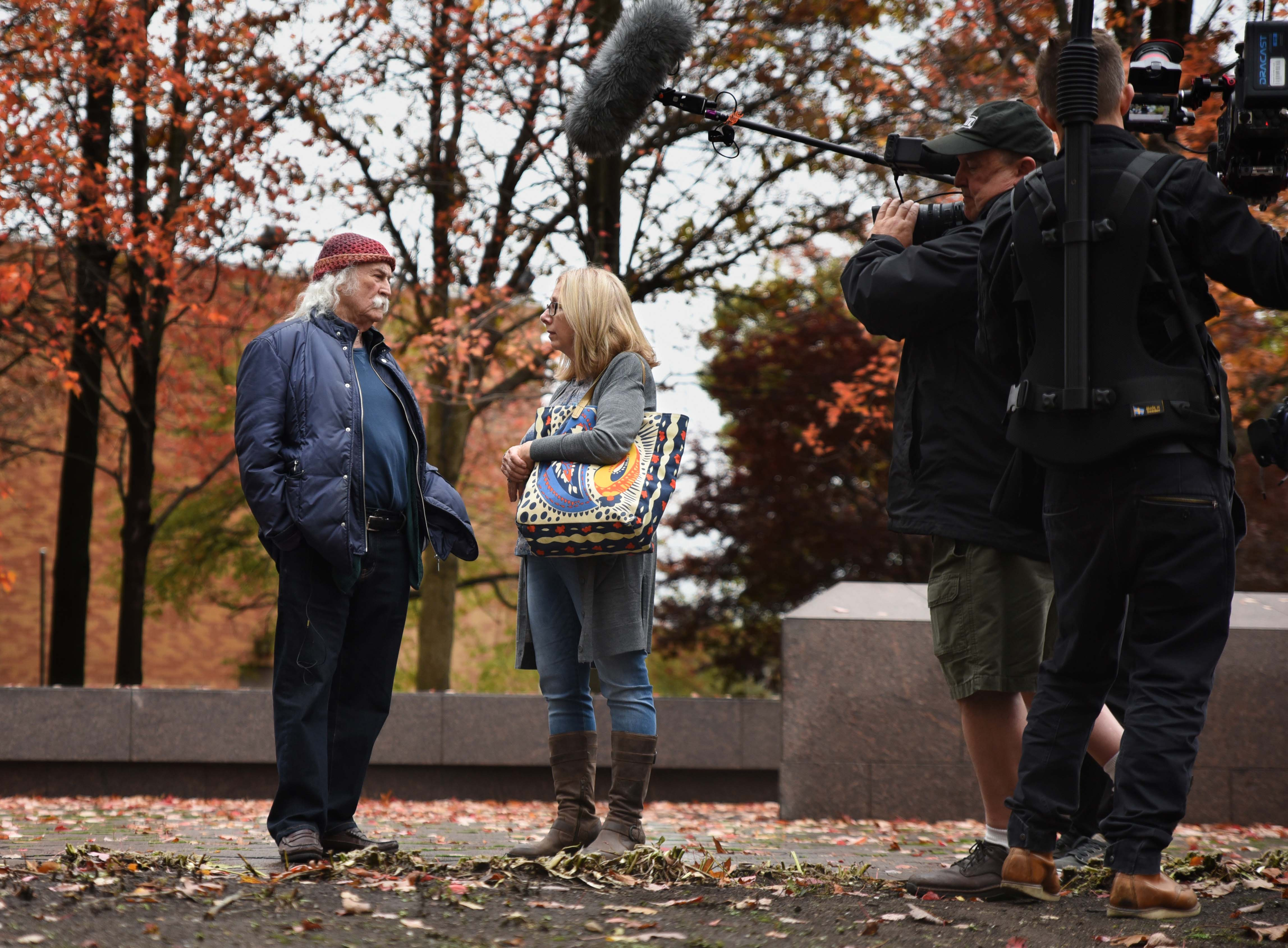 Singer-songwriter David Crosby talks to Laura Davis, Kent State Professor Emerita of English and founding director of the May 4 Visitors Center, at the May 4 Memorial.