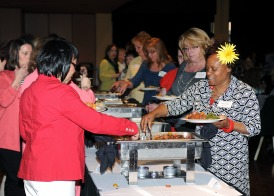 Office Support Staff enjoy a buffet and entertainment in honor of Administrative Professionals Day, April 23, 2014.
