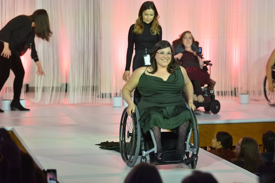 """Model in wheelchair on runway wearing a garment from Kaycee's Marshall's collection """"The Engine That Did It All"""""""