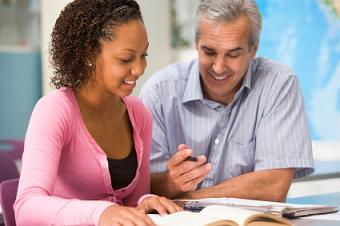 TEFL Student Instructing Elderly English Learner