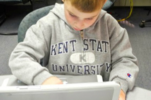 Photo of Young Boy Using Technology for AT&T Classroom Technology Summer Camps