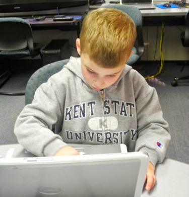 A child uses a computer to learn
