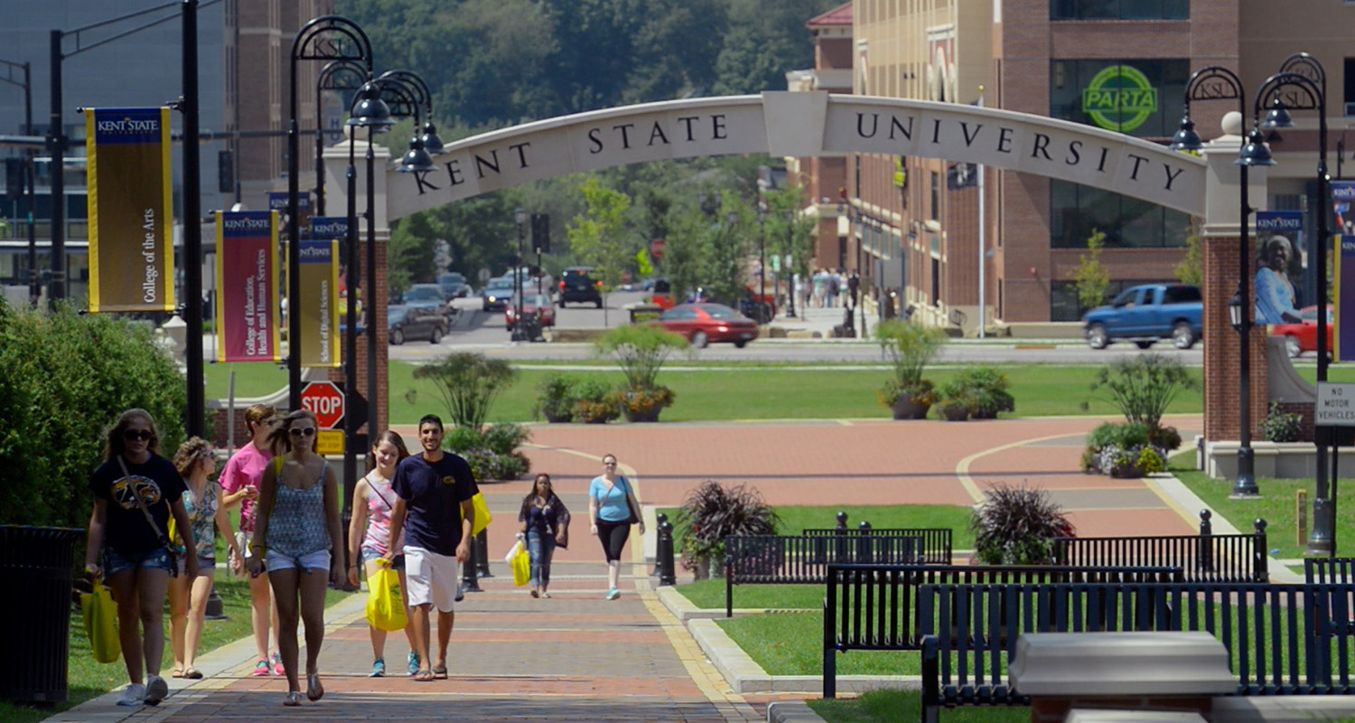 Kent State University students stroll along the Lefton Esplanade heading back to campus from downtown Kent.