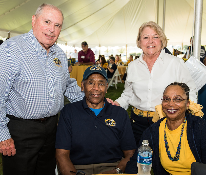 The Ashburys (seated) and Starners attend a Kent State event.