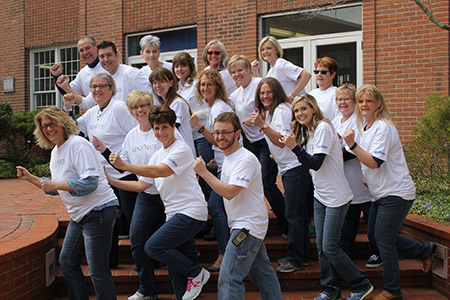 Employees at Kent State University at Ashtabula get ready to move during last year's On the Move Challenge.