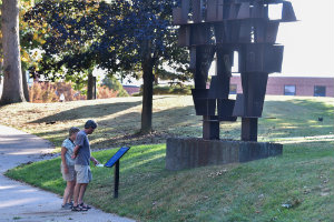 A sculpture on campus encourages passersby to stop and reflect