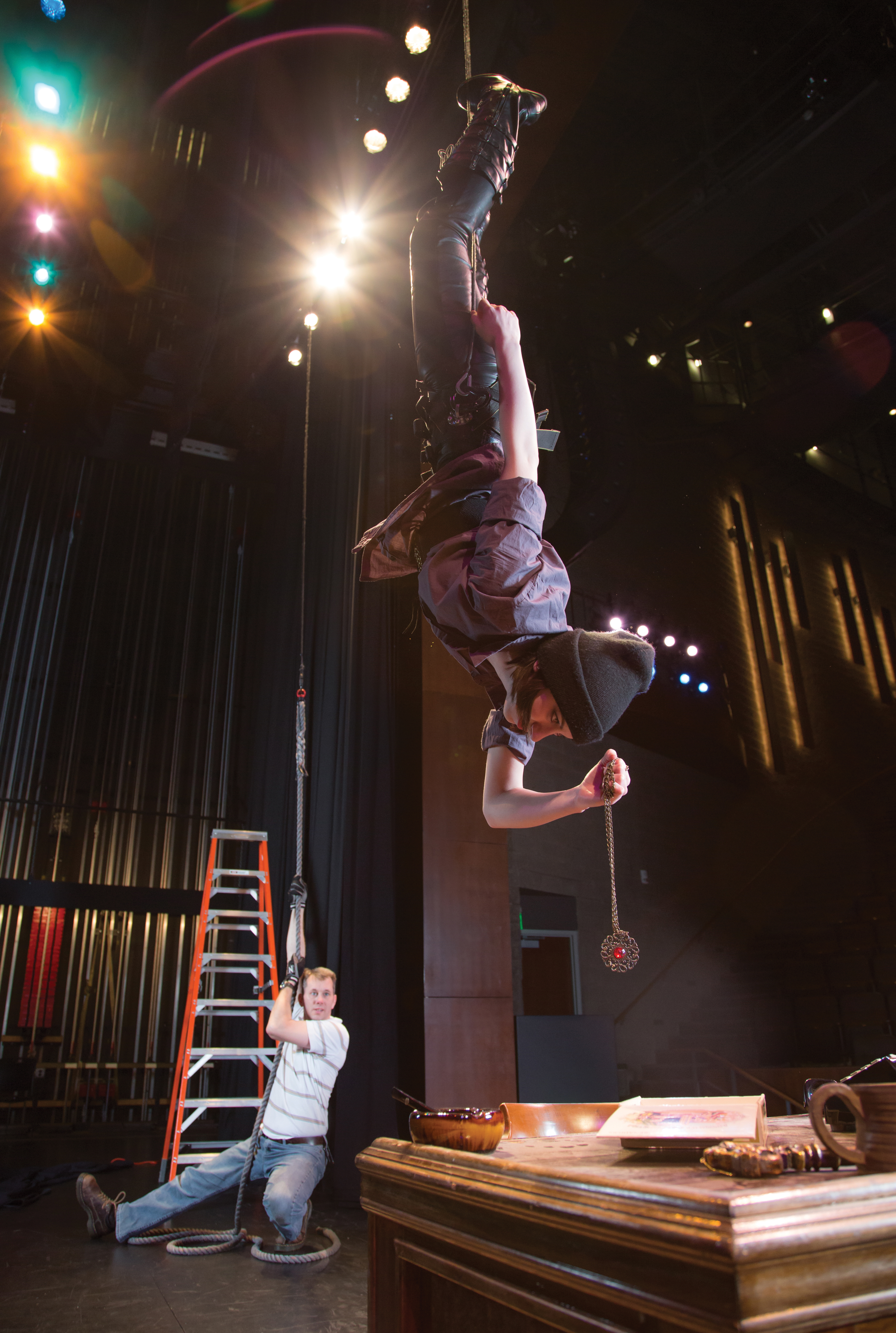 Pictured here at the Performing Arts Center in Tuscarawas, Bill Auld coaches Kent State junior and theatre studies major Alexandria Roberts on how to perform while on the wire—in this instance, in the role of a jewel thief. Photo by Melissa Olson