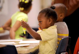 Children from the Child Development Center at Kent State University participate in creative activities during the center's community festival to mark its 40th anniversary.