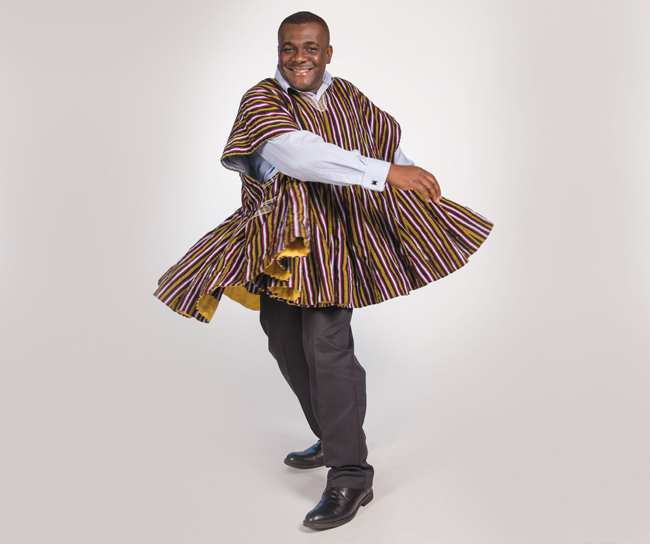 Pan-African studies professor Felix Kumah-Abiwu, PhD, wears a Ghanaian smock from his native country—its edges swirl in a circle when performing the traditional damba dance. Photo by Melissa Olson
