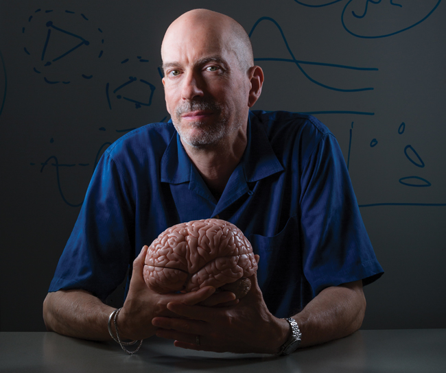 MIT neuroscientist Earl Miller, BA '85, is exploring how to expand our brainpower. Photo by Jason Grow