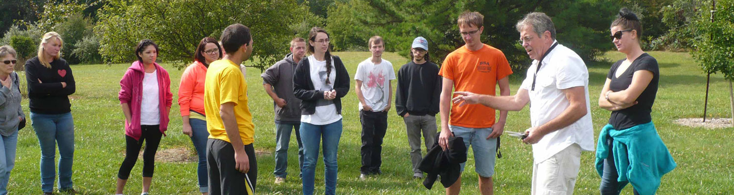 Associate Professor Chris Carlson gives instructions to students in his horticulture soils class before gathering vegetables from the Discovery Garden.